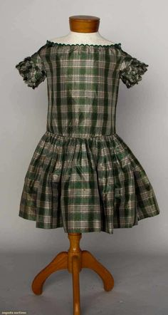 Boy's Silk Plaid Dress Made Of Green And White Taffeta, Ruffled Short Sleeves And Hand Embroidered Neckline Edge   c.1840-1850's