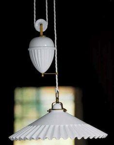 The white Duse 2115  ceramic pendant light by Aldo Bernardi, via Remodelista