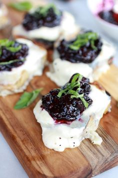 Blueberry Basil Balsamic Mozzarella Crisps |  1 pint blueberries 1 tablespoon honey 1/4 cup balsamic vinegar 1/2 lemon, juiced 2 tablespoon fresh basil chopped 5 ounces fresh mozzarella cheese, diced 1 1/2 tablespoon canned coconut milk or heavy cream 1/2 tablespoon olive oil, plus more for brushing 1/2 of a whole grain baguette, sliced into 12 half inch thick slices salt and pepper, for sprinkling fresh basil, for garnish