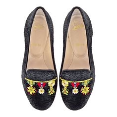 Christian Louboutin  Embellished black Astrakhan slippers, €795.