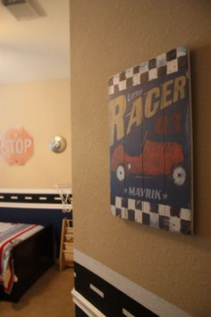Vintage sign, and street stripe above chair rail. Race car room.