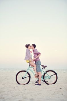 Sweet couple kissing on the beach.