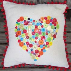 Handmade pillow with buttons attached in a heart  live. love. scrap