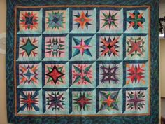 Queen geometric batik patchwork quilt  by MooseCarolQuilts on Etsy