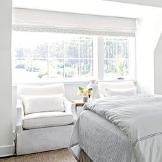 Guest Suite: The Bedroom | Always place a comfortable seat near a window that looks out on the water so you can savor the view.