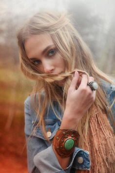 model posing face hippie, bracelets, braid, festival style, long hair, denim shirts, leather cuffs, boho, bohemian
