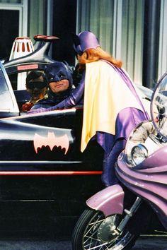 Batman gets a little flirty with Batgirl.  Robin is his wing man.