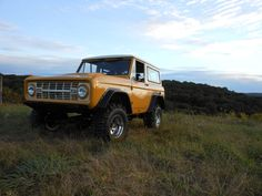 I have a soft spot in my heart for yellow Ford Broncos.  Early Broncos will turn your frown upside down.  No pun intended.  Roll cage required.  LOL