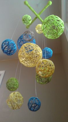 Yellow Blue & Green Yarn Ball Baby Mobile by inthe2doghouse, via Etsy.