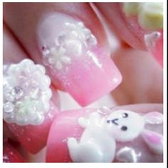 3D pink Easter bunny nails.