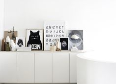 sleek and simple storage cabinets, living room storage, interior, art corner, cat, offic, alphabet, picture frame arrangements, storage ideas