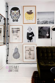 dosfamily wall of pictures. Sugar skull Carlos, Concorde, apple , pirum parum , living room , mirror and a cord of light bulbs. girls and badger.