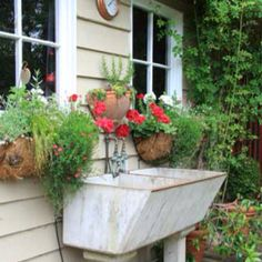 old laundry sink as potting sink