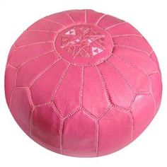 """Handmade leather pouf with a medallion design.   Product: PoufConstruction Material: Genuine leather and shredded foam fillColor: Dark pinkFeatures:    HandmadeCan be used as an ottoman or extra seating  Dimensions: 12"""" H x 21"""" Diameter"""