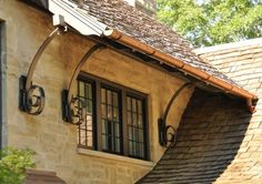 Very cool detail for roof support.  Love the copper gutters too.