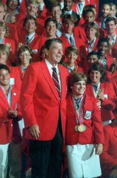President Ronald Reagan posing with Mary Lou Retton and the 1984 U.S. Olympic team at the Century Plaza Hotel, Los Angeles, California. 8/13/84.