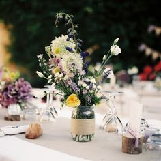 Lavender and yellow centerpieces at vineyard wedding in Provence, France
