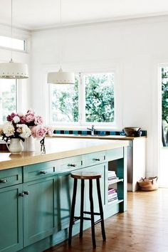 white kitchen + pop of blue with wood counter