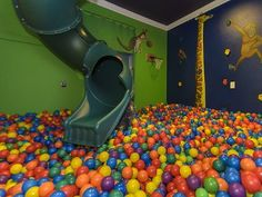 ball pit and rock climbing room with 2 story slide