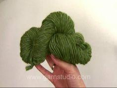 How to wind a hank of yarn into a ball of yarn - tutorial video by Garnstudio DROPS Design.