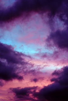 Violet-Hued Sunset Behind The Storm Clouds