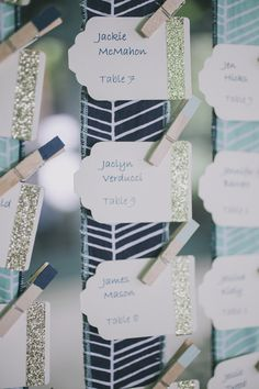 escort cards with a bit of glitter, photo by Edyta Szyszlo http://ruffledblog.com/allied-arts-guild-wedding #weddingideas #escortcards
