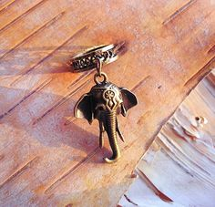 Hey, I found this really awesome Etsy listing at https://www.etsy.com/listing/115380554/antiques-brass-elephant-charm-add-to