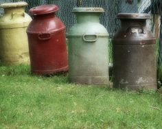 Antique milk cans in country colors.