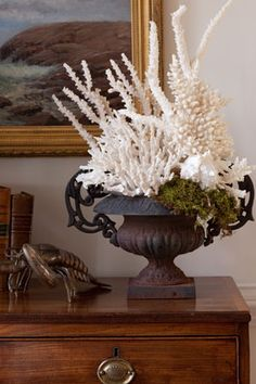 love the use of coral and dried moss as an arrangement in this urn