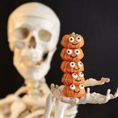 This Halloween, give guests a mini tower of cute pumpkins! Easy to bake in Wilton's mini doughnut pan and easy to decorate with Candy Melts® Candy and little candy eyeballs. doughnuts, pumpkin, mini doughnut, candies, doughnut pan, candy melts, wilton mini, mini tower, halloween