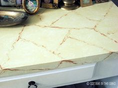painted countertops...tutorial at www.cottageintheo...