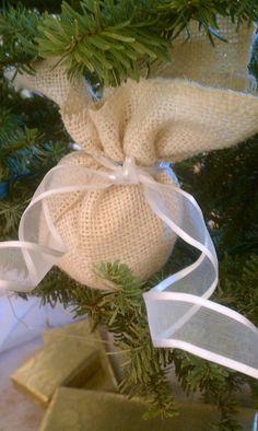 Styrofoam ball, burlap, rubber band, ribbon... super easy ornament!