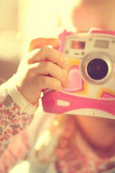 I got a Nikon camera   I love to take a photograph
