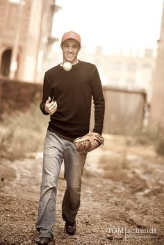 Great action photo.  The smile and mood perfectly captures a young man's joy for baseball in his senior portrait.