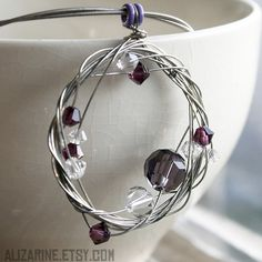Upcycled guitar string jewelry - so cool