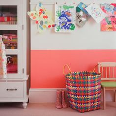 Kids art display- hang small pine strip using double-sided tape and then use pin-tack clothespins to attach the art.