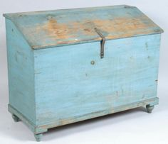 """Sold For $1,300                                                          Lebanon County, Pennsylvania 19th Century Pine Feed Chest with Original Blue Paint. Hinged slant-lid with original iron hasp, compartmented interior, dovetailed case, molded base and turned turnip feet. Found at the original farmhouse in Milbach, Lebanon Co., PA. 36""""h x 47 1/4""""w x 21""""d. Condition: good with expected wear, all original."""