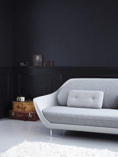 dark wall / grey sofa