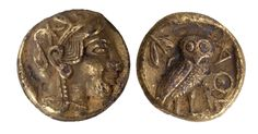 Ancient Greek. Gold tetradrachm coin with Athena, Goddess of Wisdom, wearing an ornamented helmet, on the back, a standing owl with an olive twig on the upper left. 400 BC