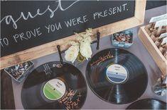 vinyl record guest book, photo by Hazelwood Photo http://ruffledblog.com/portland-wedding-with-music-inspired-details #weddingideas #guestbook