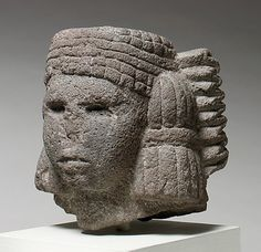 """The Aztecs carved thousands of images of their gods in stones ranging from much-valued greenstones to ordinary volcanic rock. Sculptures like the present example were probably set up in household shrines where they were worshipped in family settings rather than in public ceremonies. Frequently portrayed Aztec deities are fertility goddesses, which include the water goddess Chalchihuitlicue (""""she of the jade skirt"""") depicted here. Identifying elements of the water goddess are the distinctive h..."""