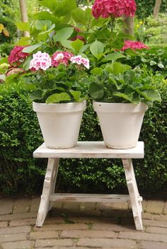 ♥ paint an old stool and  2 or 3 pots the same color - use exterior grade paint - add colorful plants and enjoy!