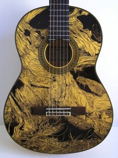 Beautiful ink drawings on guitars by Patrick Fisher.