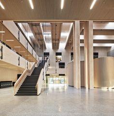 Nord-Østerdal High School / Longva arkitekter, glu-lam beams, clt roof decking, suspended walkways, garbage recycling bins, entry hall, commons, stair, wood ceilings, skylights
