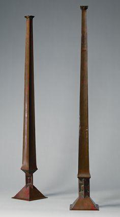 "Frank Lloyd Wright (1867-1959) - Pair of Vases. Copper. Circa 1890-1900. 29-1/8"" x 4-1/8"". The Metropolitan Museum of Art. New York."