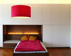 Children's bedroom by Holzrausch. I like the seating area next to the bed which doubles as a table.