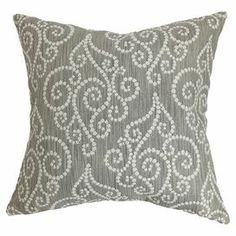 "Cotton pillow with a down-feather fill and scrolling motif. Made in Boston, Massachusetts.   Product: PillowConstruction Material: Cotton cover and 95/5 down fillColor: GraphiteFeatures:  Insert includedHidden zipper closureMade in Boston Dimensions: 18"" x 18""Cleaning and Care: Spot clean"