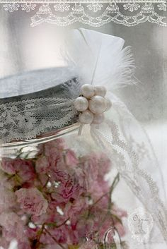 Pink petals.  Great idea -  Dried flowers in a mason jar, with some lace and pearls.  :)