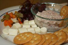 Tuna salad, mozzarella cubes, and fresh fruit and veggies