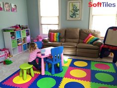 A beautiful girls playroom using SoftTiles Die-Cut Circles Foam Mats. This mat twists the traditional kids colors of red, yellow, blue, and green by substituting lime and pink to make the perfect girls playroom floor. #playrooms